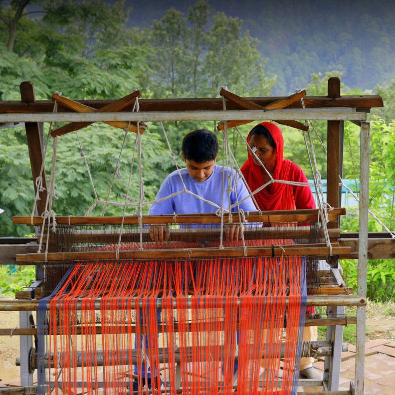 A Child learning Himachali Shawl Weaving